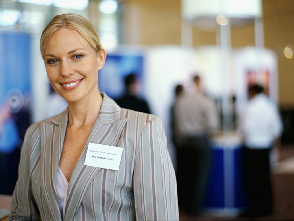 portrait of a businesswoman smiling at an exhibition