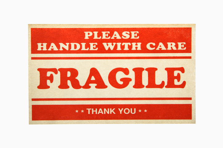 Fragile handle with care sign against white background.